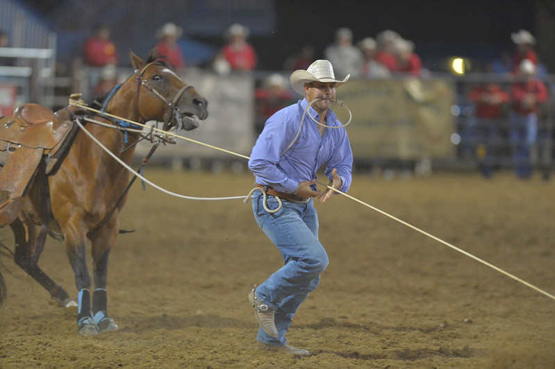 Justin Sheely | The Sheridan Press<br /> Sheridan competitor EJ Penetta does tie-down roping during the Sheridan WYO Rodeo Friday at the Sheridan County Fairgrounds.