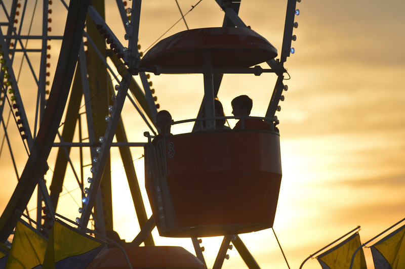 Justin Sheely | The Sheridan Press<br /> Carnival goers ride the Ferris Wheel during the Sheridan WYO Rodeo Friday at the Sheridan County Fairgrounds.