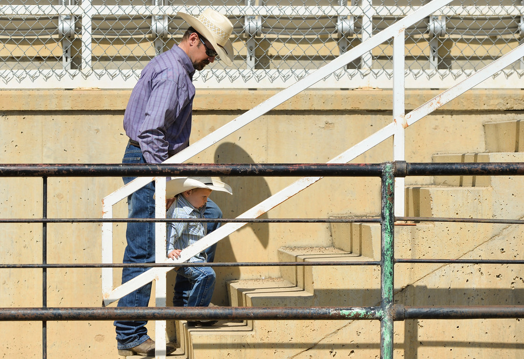 Justin Sheely | The Sheridan Press<br /> Kyle Berger of Laramie, Wyoming, helps his son Brexton Berger, 2, up the stairs during the Sheridan High School Rodeo at the Sheridan County Fairgrounds Saturday, May 26, 2018.