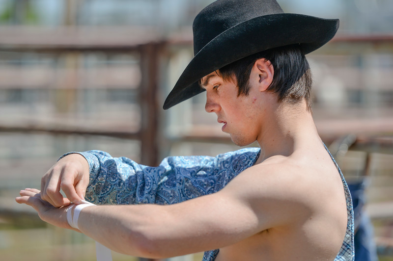 Justin Sheely | The Sheridan Press<br /> High school junior Donny Proffit of Kemmerer, Wyoming, tapes up his wrist in preparation for bareback riding during the Sheridan High School Rodeo at the Sheridan County Fairgrounds Saturday, May 26, 2018.