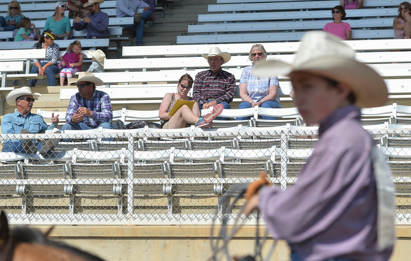 Justin Sheely | The Sheridan Press<br /> Spectators visit from their seats during the Sheridan High School Rodeo at the Sheridan County Fairgrounds Saturday, May 26, 2018.