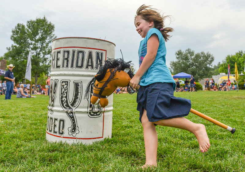 Justin Sheely | The Sheridan Press<br /> Six-year-old Kacee Bercot turns the barrel for the stick horse races during the Sheridan WYO Rodeo Boot Kickoff at Whitney Commons Park Tuesday, July 10, 2018. Bercot won first in her age division.