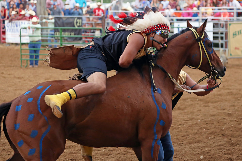 Mike Pruden | The Sheridan Press<br /> Richard Long Feather and his horse take off during the World Champion Indian Relay Race at the Sheridan County Fairgrounds Wednesday, July 11, 2018.