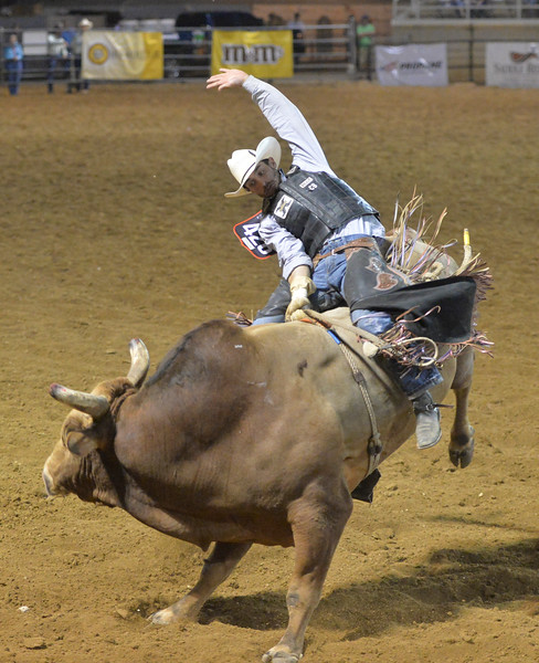 Justin Sheely | The Sheridan Press<br /> Elliot Jacoby of Fredericksburg, Texas, rides a bull during the Sheridan WYO Rodeo at the Sheridan County Fairgrounds Wednesday, July 11, 2018.