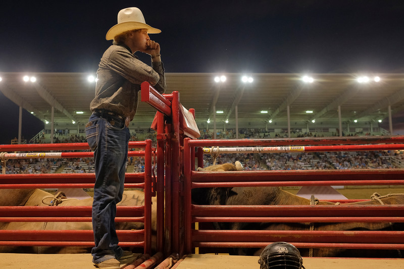Justin Sheely | The Sheridan Press<br /> Colton Bagent of Casper, Wyoming, waits to assist bull riders on the bucking chutes during the Sheridan WYO Rodeo at the Sheridan County Fairgrounds Wednesday, July 11, 2018.