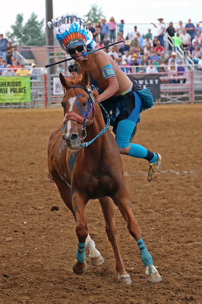 Mike Pruden | The Sheridan Press<br /> Lynwood His Bad Horse Jr. dismounts his horse in a World Champion Indian Relay Race heat during the Sheridan WYO Rodeo at the Sheridan County Fairgrounds Wednesday, July 11, 2018.