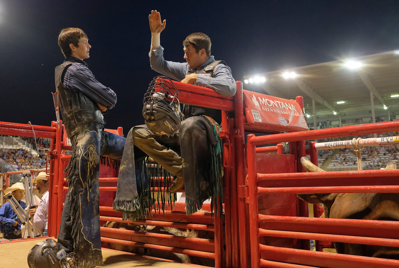 Justin Sheely | The Sheridan Press<br /> Colorado bull riders Cory Price, left, and Cordell Cortis visit by the bucking chutes during the Sheridan WYO Rodeo at the Sheridan County Fairgrounds Wednesday, July 11, 2018.