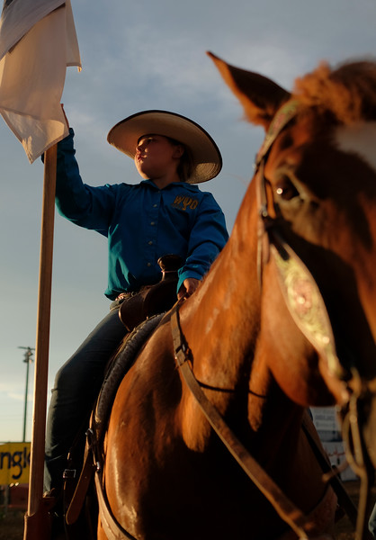 Kakie Schreibeis holds a flag on top of her horse during the Sheridan WYO Rodeo at the Sheridan County Fairgrounds Wednesday, July 11, 2018.