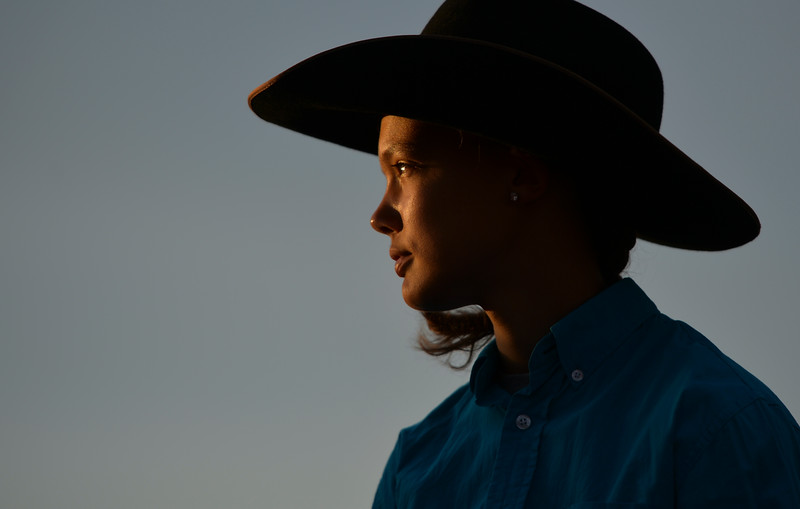Justin Sheely | The Sheridan Press<br /> Fifteen-year-old Meghan Anthon watches the arena action during the Sheridan WYO Rodeo at the Sheridan County Fairgrounds Wednesday, July 11, 2018.