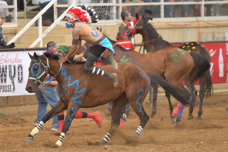 Matthew Gaston | The Sheridan Press<br>The Tillman Team's Jared Cerino dismounts for the exchange on the second lap of the third heat of the Indian Relay Races at the Sheridan WYO Rodeo Saturday, July 13, 2019.