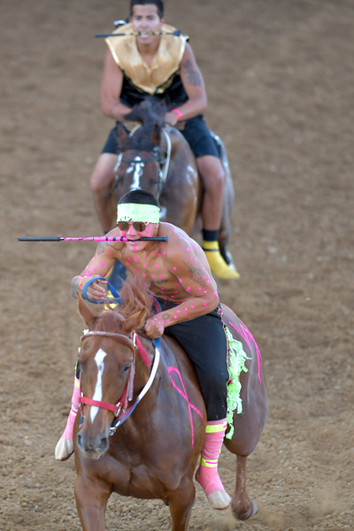 Matthew Gaston | The Sheridan Press<br>J'Ree Old Bull takes the lead with Jace Long Feather hot on his heels during the second heat of the Indian Relay Races Thursday, July 11, 2019.
