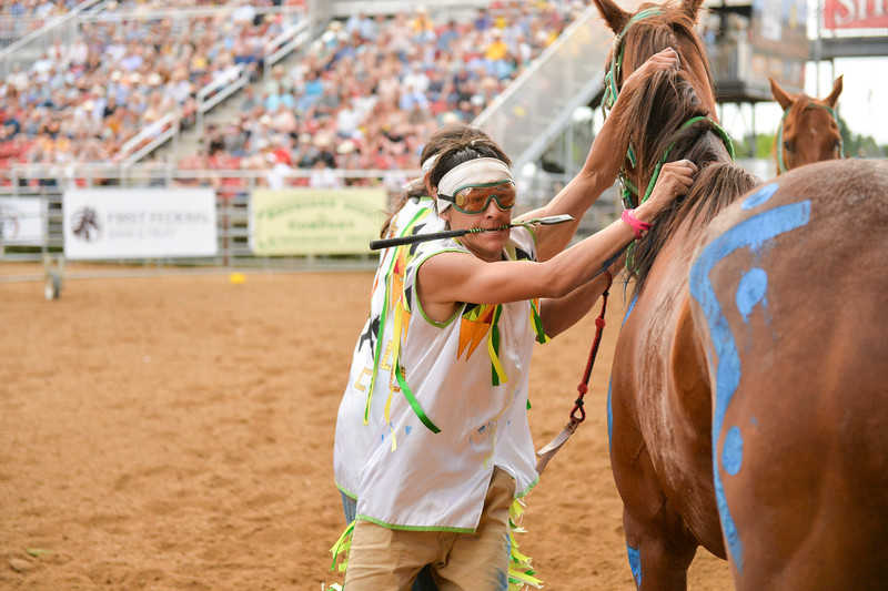 Ashleigh Snoozy | The Sheridan Press<br>Shoshone Tillman Team jockey Jared Cerino prepares to hop on his next horse during the first consolation for the World Championship Indian Relay race Saturday, July 13, 2019.