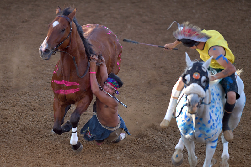 Matthew Gaston | The Sheridan Press<br>Joe Yellow Fat falls from his horse during the Indian Relay Races at the Sheridan WYO Rodeo Thursday, July 11, 2019.