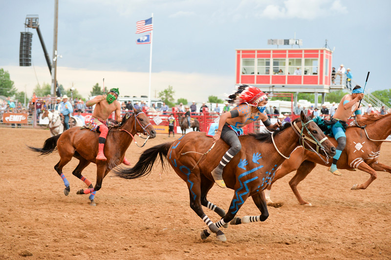Bud Denega | The Sheridan Press<br>Jockeys rush past during the World Champion Indian Relay race Saturday, July 13, 2019.
