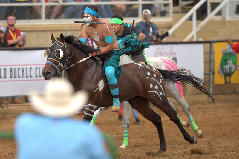 Matthew Gaston | The Sheridan Press<br>Lynwood His Bad Horse Jr. edges past S/M Express' Dustin Kruger during the first consolation heat of the Indian Relay Races Saturday, July 13, 2019.