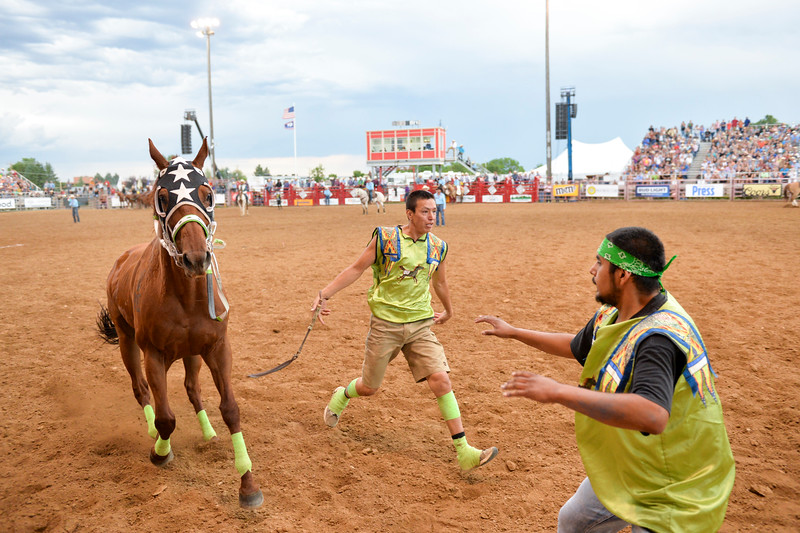 Bud Denega | The Sheridan Press<br>Joey Guteirrez, jockey for Mountain Crow from Pryor, Montana, rushes to his next pony during the World Champion Indian Relay race Saturday, July 13, 2019.
