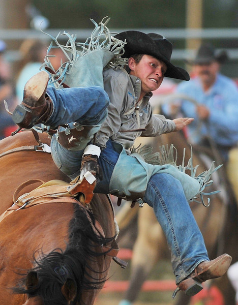 Justin Kissack rides in Bareback Bronc Riding for a 58 score during the Sheridan County Rodeo Friday night at the Sheridan County Fairgrounds. (Justin Sheely/The Sheridan Press)