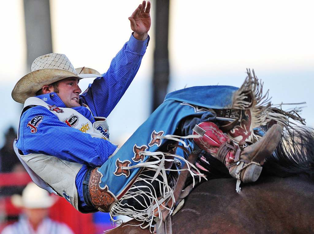 Kaycee Field, from Payson, Ariz., rides Out Cast during Bareback Riding Friday night at the Sheridan-Wyo-Rodeo in the Sheridan Fairgrounds. (Justin Sheely/The Sheridan Press)