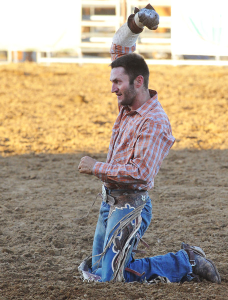 Morgan Heaton, of Paradise, Utah, shows his satisfaction after a bareback ride, which scored 80 during the Sheridan-Wyo-Rodeo Wednesday night at the Sheridan County Fairgrounds. (Justin Sheely/The Sheridan Press)