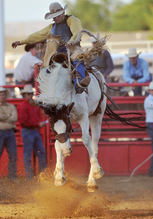 Sheridan cowboy Taylor Kelly competes in Saddle Bronc Riding during the Sheridan County Fair Match Bronc Riding Thursday evening at the Sheridan County Fairgrounds arena. Kelly finished the round in third place with overall score of 69. (Brad Estes/The Sheridan Press)