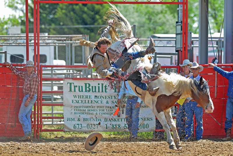 Grant Griffin follows his hat to the dirt during his bareback ride Monday afternoon. (Brad Estes/The Sheridan Press)
