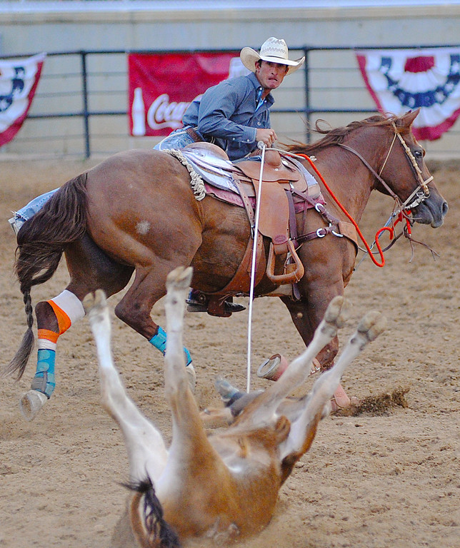 JoJo LeMond, of Baker, Mont., hops off his horse in the Steer Roping competition Thursday night in the Sheridan-Wyo-Rodeo at the Sheridan County Fairgrounds. (Justin Sheely/The Sheridan Press)