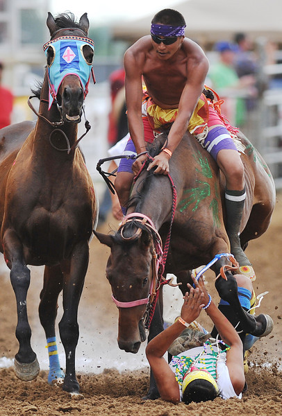 Brandon Weed's horse hits Curly Relay team jockey Clyde Jefferson during an exchange in the third heat of Thursday's World Champion Indian Relay Races at the Sheridan County Fairgrounds. Jefferson got up and finished the race after the accident. (Justin Sheely/The Sheridan Press)