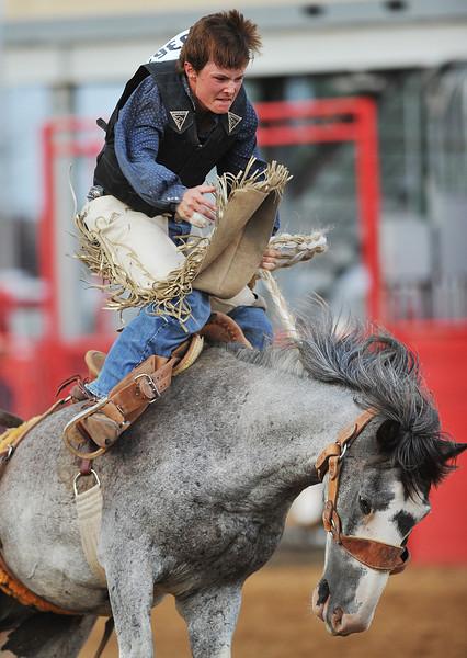 Kale Tisbert competes in Saddle Bronc Riding during the Sheridan County Rodeo Friday night at the Sheridan County Fairgrounds. (Justin Sheely/The Sheridan Press)