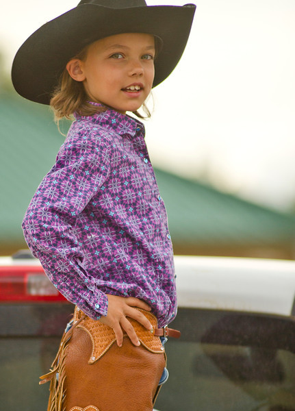 Meghan Anthony, 10, stands in the bed of a pickup truck Friday at the Sheridan County Fairgrounds. Anthony and her sister will be participating in the Sheridan County Rodeo this weekend which is scheduled Saturday at 1 and 7 p.m. Sunday 1 p.m. at the Sheridan County Fairgrounds.