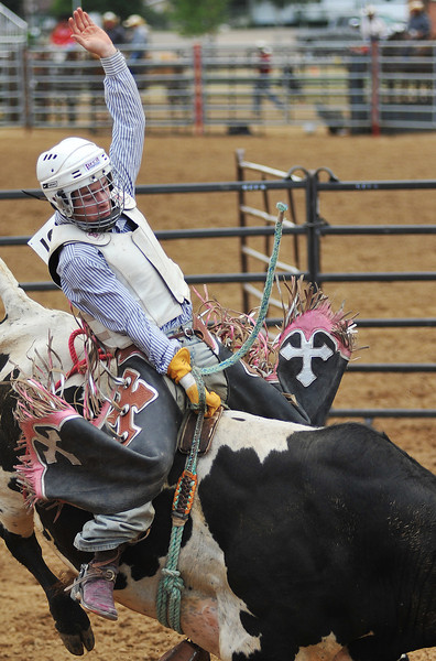 Bryce Burnell competes in Bull Riding at the Sheridan County Rodeo Saturday afternoon at the Sheridan County Fairgrounds.(Justin Sheely/The Sheridan Press)