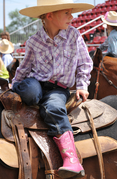 Izabell Hendricks, 6, sits on her horse as she waits for her turn to compete in Pee Wee Pole Bending and Goat Tail Tying during the Sheridan County Rodeo Saturday afternoon at the Sheridan County Fairgrounds. (Justin Sheely/The Sheridan Press)