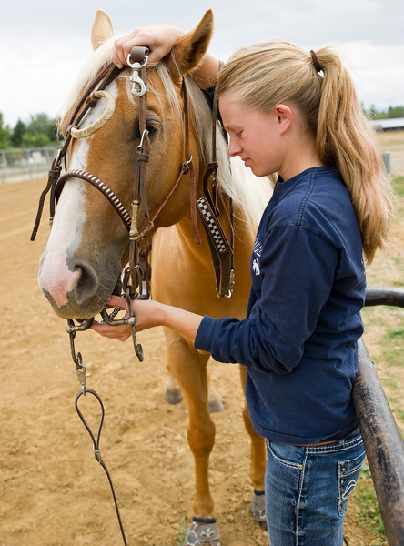Katy Bilodeau bridles her horse Derby for a quick ride before the Sheridan County Rodeo Friday at the Sheridan County Fairgrounds. Bilodeau will be competing in barrel races and pole bending.