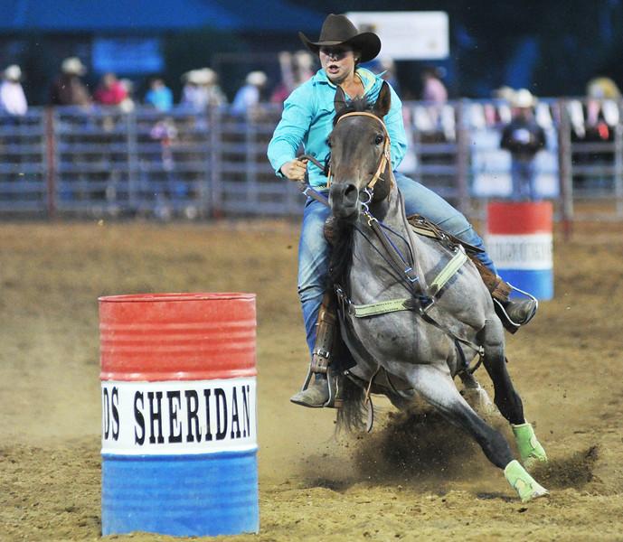 Tiare Ilgen bends around the third barrel in in Women's Barrel Race during the Sheridan County Rodeo at the Sheridan County Fairgrounds.