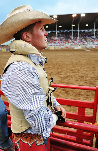 "Ty Breuer, of Mandan, N.D., watches the replay of his ride on the ""JumboTron"" display during Bareback Riding Thursday at the Sheridan-Wyo-Rodeo. (Justin Sheely/The Sheridan Press)"