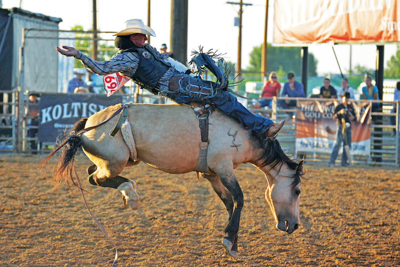"Logan Hodson of Telkwa, British Columbia finishes his ride on ""Daisy"" for a 76 Wednesday at the 83rd edition of the Sheridan-Wyo-Rodeo. (Brad Estes/The Sheridan Press)"