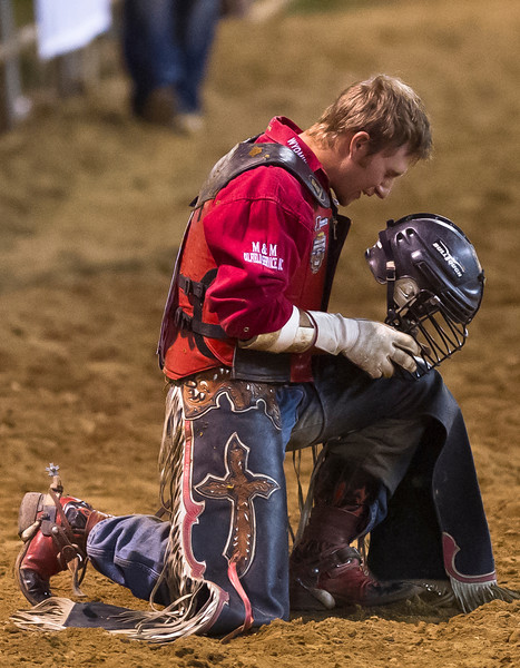 Bobbly Welsh, of Gillette, Wyo., pauses for a prayer after a successful bull ride, which landed him an 89 score Friday during the Sheridan-Wyo-Rodeo at the Sheridan County Fairgrounds. (Justin Sheely/The Sheridan Press)