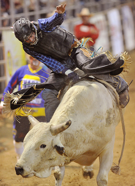 Clayton Foltyn, from Winnie, Texas, competes in Bull Riding Thursday night at the Sheridan-Wyo-Rodeo. (Justin Sheely/The Sheridan Press)