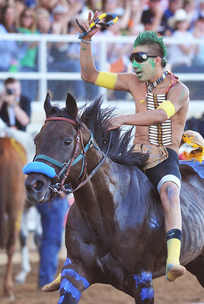 Darren Charges Strong, with team Coup Counters of the Crow Nation, waves to the audience after winning the fourth heat of the World Champion Indian Relay Race Wednesday at the Sheridan County Fairgrounds.