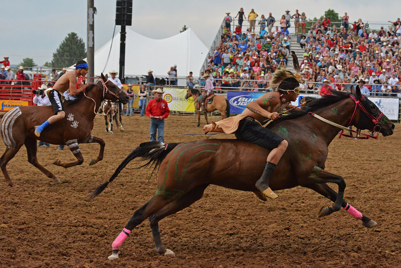 Two jockeys take off from a standing start during a heat of the World Champion Indian Relay Races Thursday at the Sheridan-Wyo-Rodeo.