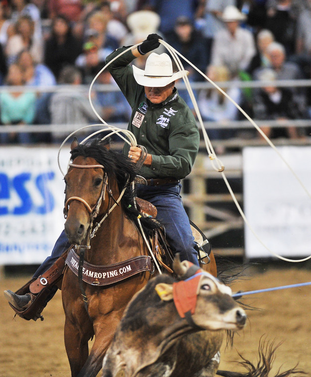 Clay O'Brien Cooper, of Gardnerville, Nev., rides on the heels of the steer in Team Roping Saturday night during the Sheridan-Wyo-Rodeo at the Sheridan County Fairgrounds arena. (Justin Sheely/The Sheridan Press)