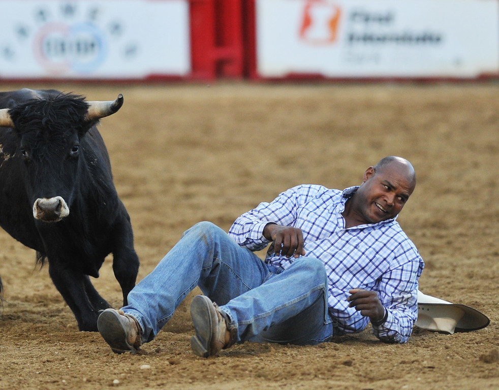 Tommy Cook, from McAlester, Okla., gets up after bringing his steer down for a 14.5 score during Steer Wrestling Saturday at the Sheridan-Wyo-Rodeo. (Justin Sheely/The Sheridan Press)