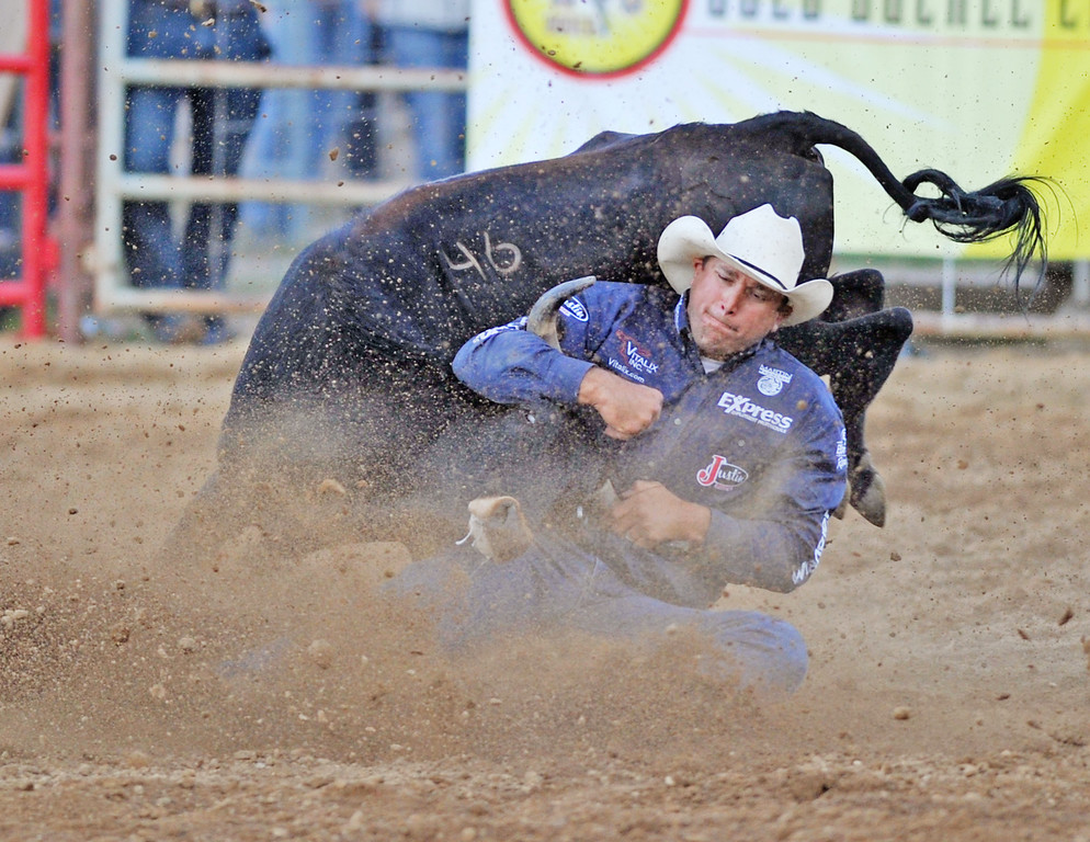 Dean Gorsuch, from Gering, Neb., competes in Steer Wrestling in the Sheridan-Wyoming Rodeo Wednesday at the Sheridan County Fairgrounds arena. (Justin Sheely/The Sheridan Press)