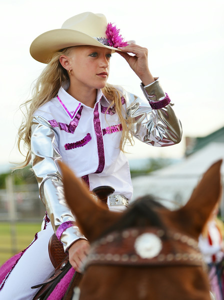 Thirteen-year-old Hannah Jost watches another contestant compete during the Rodeo Royalty horsemanship competition Saturday evening at the Sheridan County Fairgrounds.