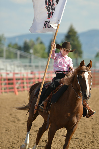 Eleven-year-old Mariah McFaul runs the Sheridan-Wyo-Rodeo flag during the Rodeo Royalty horsemanship competition Saturday evening at the Sheridan County Fairgrounds.