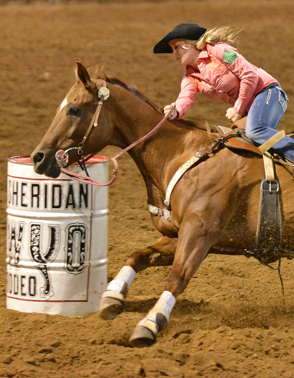 Lindsay Kruse of Great Falls, Mont., turns her horse around in the barrel racing event during the Sheridan WYO Rodeo Wednesday night at the Sheridan County Fairgrounds arena. The Sheridan Press|Justin Sheely.