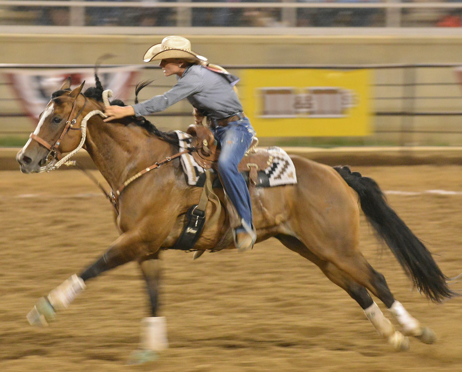 Bobbi Grann of Sheyenne, N.D., hurries her horse back to the gate in the barrel racing event during the Sheridan WYO Rodeo Wednesday night at the Sheridan County Fairgrounds arena. The Sheridan Press|Justin Sheely.