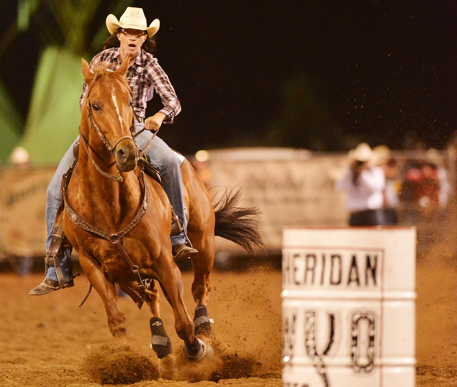 Sammi Bessert of Loma, Colorado, rides her horse to the third turn in the barrel racing event during the Sheridan WYO Rodeo Thursday night at the Sheridan County Fairgrounds. The Sheridan Press|Justin Sheely.