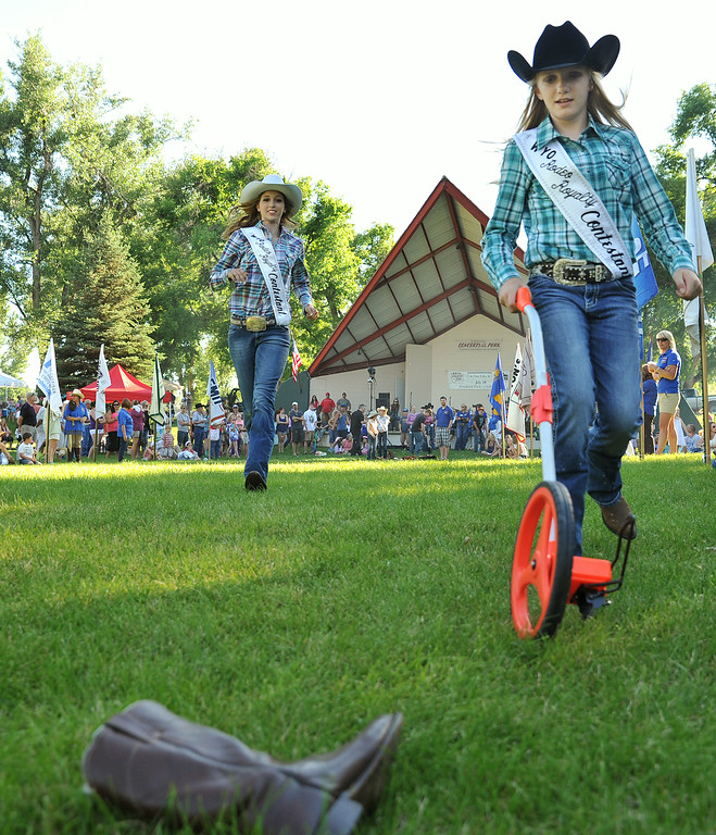 Rodeo Royalty contestants Ananna Starkovich, left, and Lainey Konetzki, 11, run up to a boot to measure the distance during the annual Sheridan-Wyo-Rodeo Boot Kick-off Tuesday at Kendrick Park.