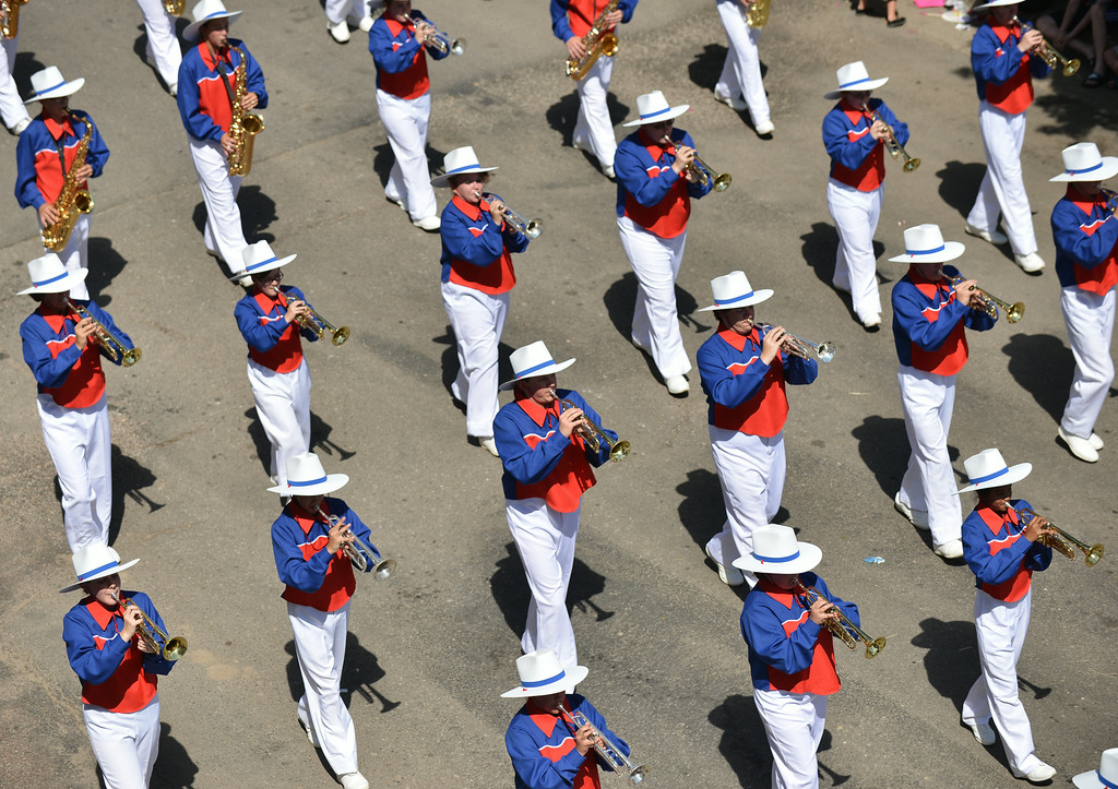The Wyoming All State Band marches on East Works Street during the 2014 Sheridan WYO Rodeo Parade Friday morning. The Sheridan Press|Justin Sheely.