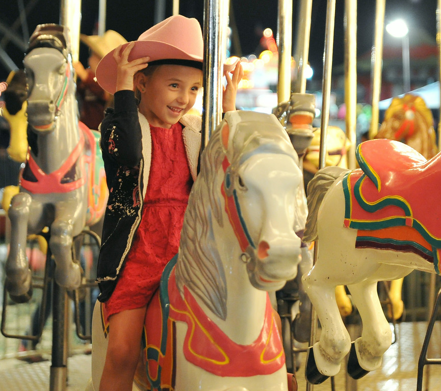 Six-year-old Lyliauna Smith gets ready for the ride to begin Saturday night at the carnival during the Sheridan WYO Rodeo at the Sheridan County Fairgrounds arena. The Sheridan Press|Justin Sheely.